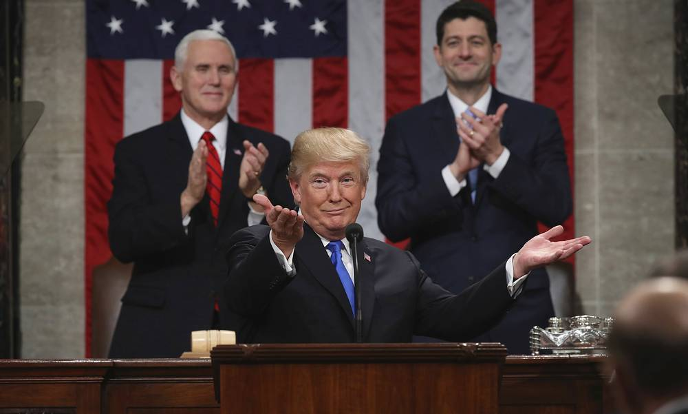 US President Donald Trump soaks up a round of applause as he delivers his first State of the Union address in the chamber of the US House of Representatives in Washington, DC, US, January 30
