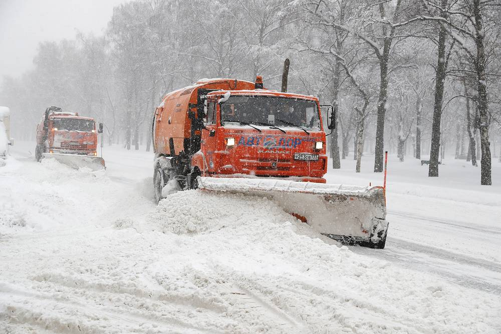 Snowplows working after heavy snowfall