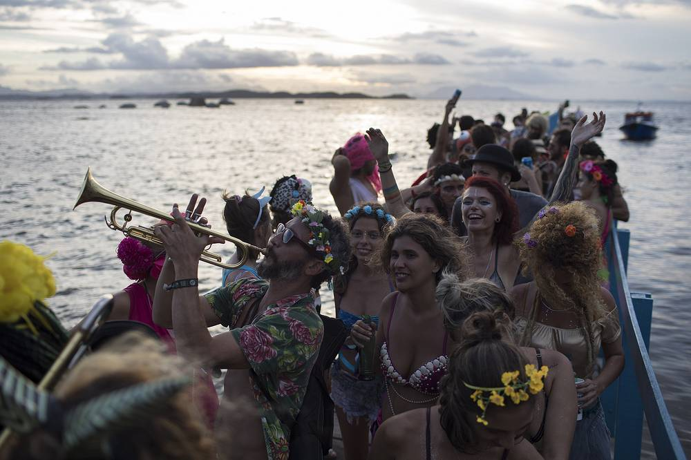 Merrymakers in Brazil take to the streets in hundreds of open-air parties ahead of Rio's Carnival