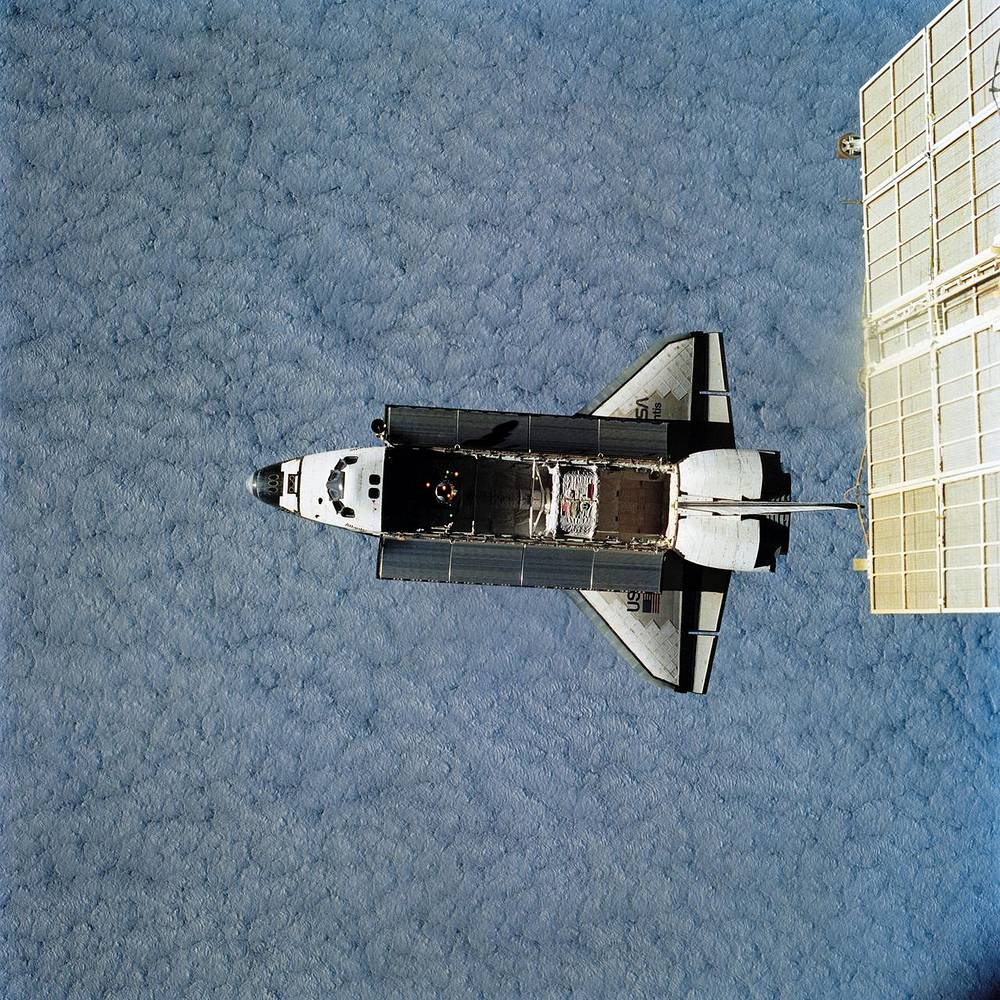 The view of the Space Shuttle Atlantis during docking operations on March 23, 1996
