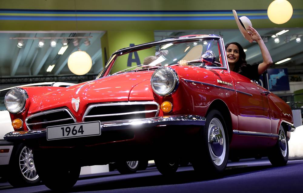 A model poses in a historic NSU Wankel Spider from 1964