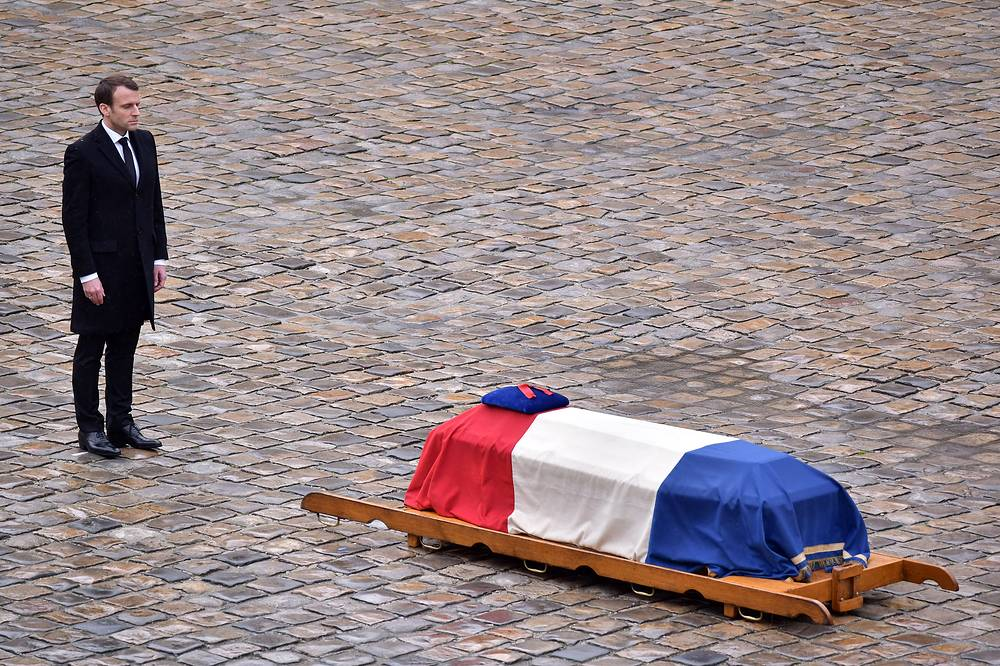 French President Emmanuel Macron stands in front of the flag-draped coffin of the Gendarme Lieutenant-Colonel Arnaud Beltrame during a solemn funeral ceremony in Paris, France, March 28. Beltrame was killed after swapping himself in exchange of a female hostage during a terrorist attack in Trebes, France