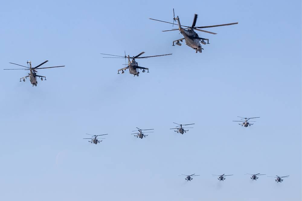 Mil Mi-24, Kamov Ka-52, and Mil Mi-28N combat helicopters rehearse an air show at the Kubinka air base
