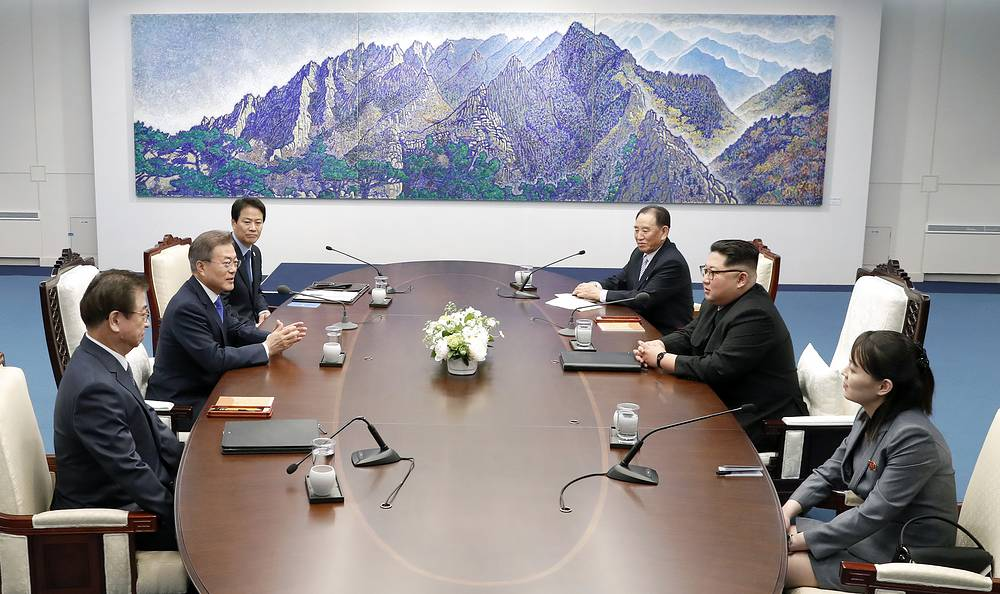 North Korean leader Kim Jong Un talks with South Korean President Moon Jae-in during a meeting at the border village of Panmunjom in Demilitarized Zone