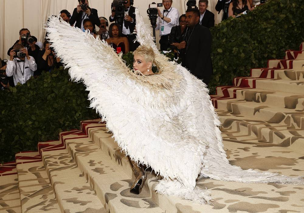 """Katy Perry arrives on the red carpet for the Metropolitan Museum of Art Costume Institute's gala celebrating the opening of the exhibit """"Heavenly Bodies: Fashion and the Catholic Imagination"""" in New York, May 7"""