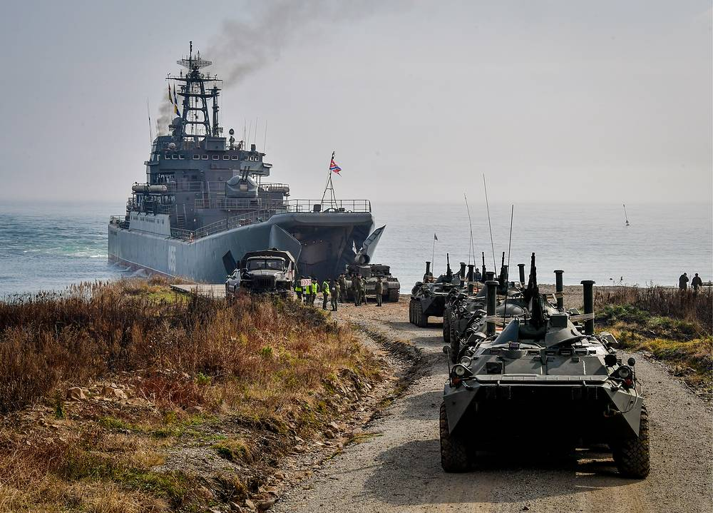 BTR-80 armoured personnel carriers landing from Admiral Nevelskoy large landing ship