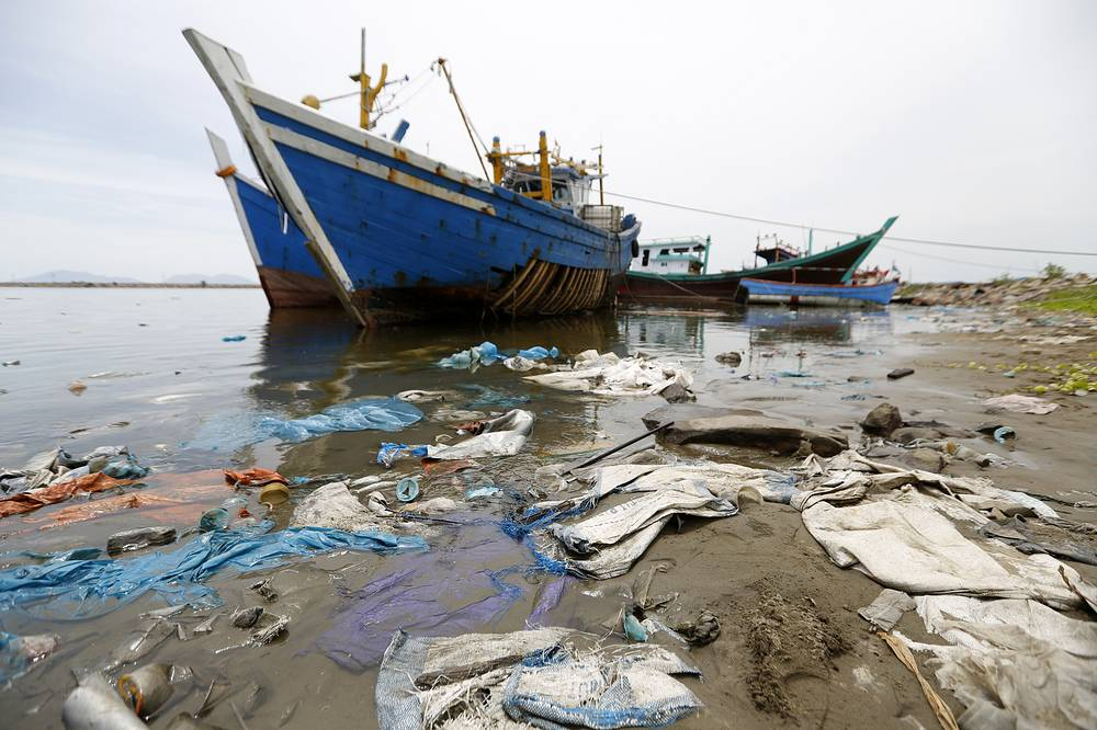 A general view of stranded wood and plastic garbage on a beach near the Lam Pulo traditional port in Banda Aceh, Indonesia