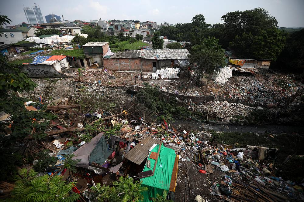 A general view of a polluted area piled with garbage in Hanoi, Vietnam