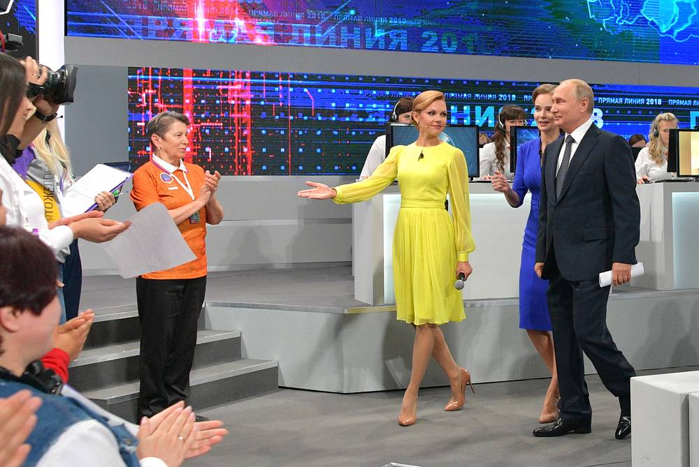 Russia's President Vladimir Putin arrives for his annual televised question and answer session