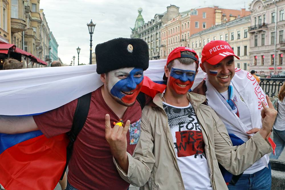 Fans of the Russian national team on the embankment of the Griboedov channel in Saint Petersburg
