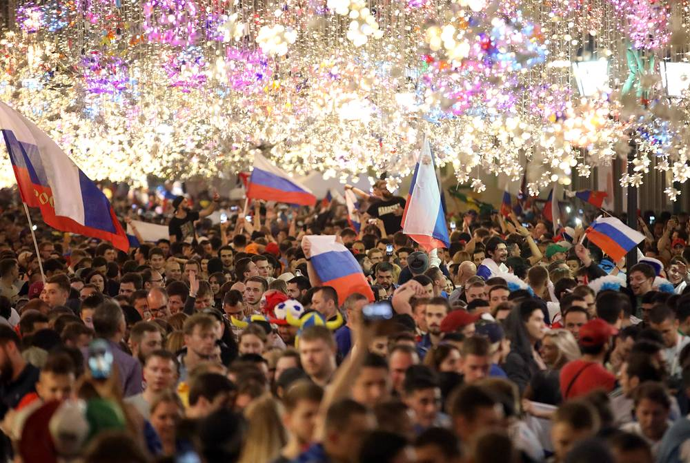 Russian football fans celebrate their team winning on Nikolskaya Street in Moscow