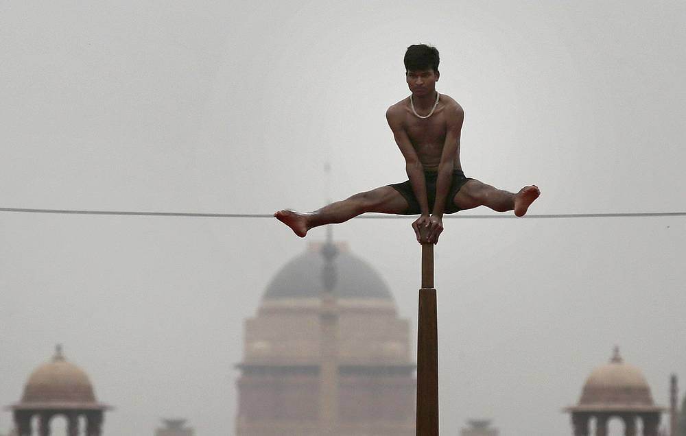 A gymnast performs aerial yoga to mark the 4th International Day of Yoga at Rajpath in New Delhi, India