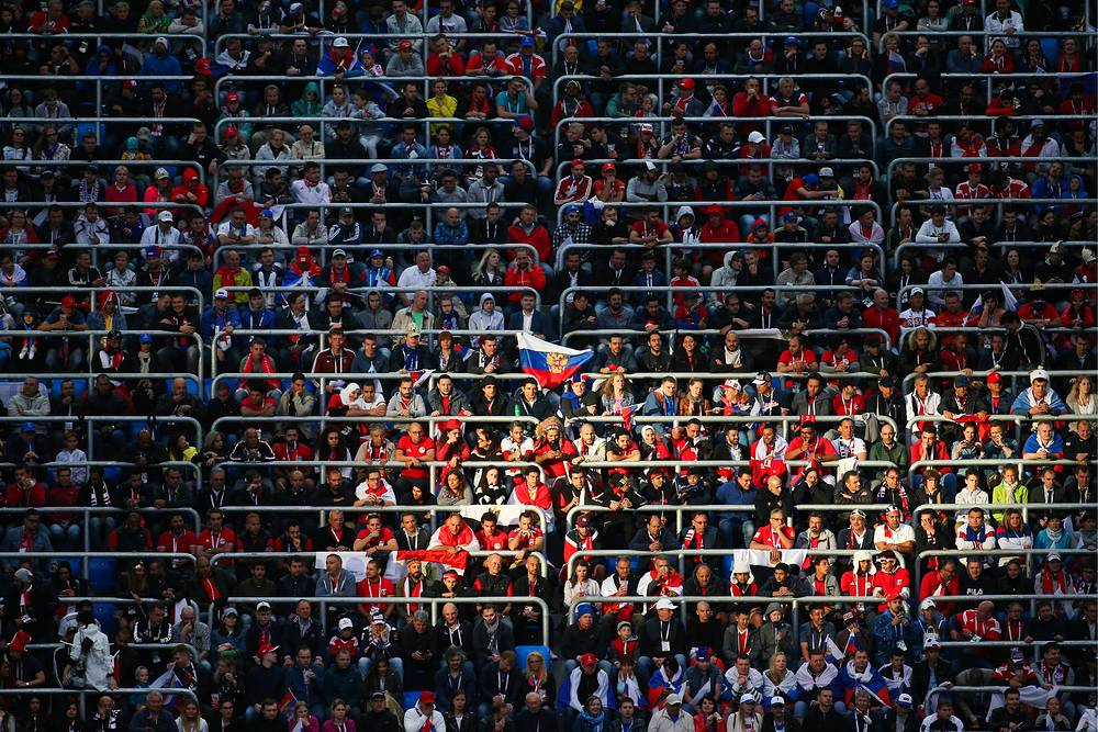 Fans watch the 2018 FIFA World Cup Group A Round 2 football match between Russia and Egypt at St Petersburg Stadium, June 19
