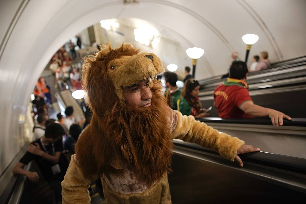 A Morocco fan wearing a lion costume arrives at Sportivnaya metro station to attend the group B match between Portugal and Morocco at the 2018 soccer World Cup in the Luzhniki Stadium in Moscow, June 20