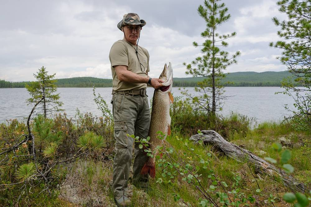 Russia's president Vladimir Putin with his catch during a fishing trip to a national nature reserve in Tyva in south-central Siberia, 2013