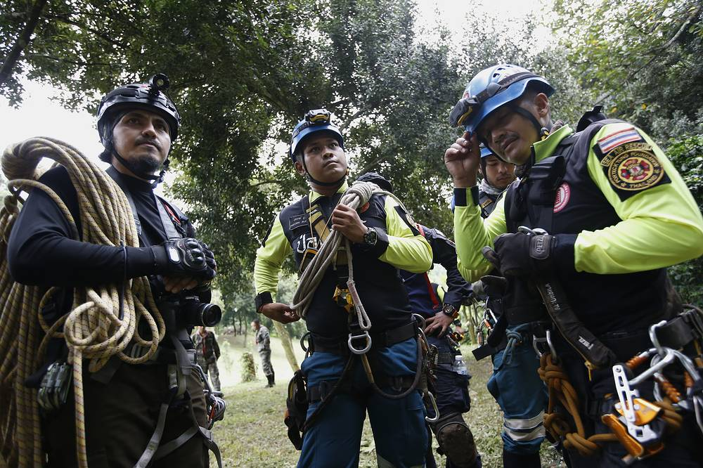 Thai rescuers prepare to search for chimneys for a drilling option during the ongoing rescue operations at a mountain forest near Tham Luang cave in Thailand