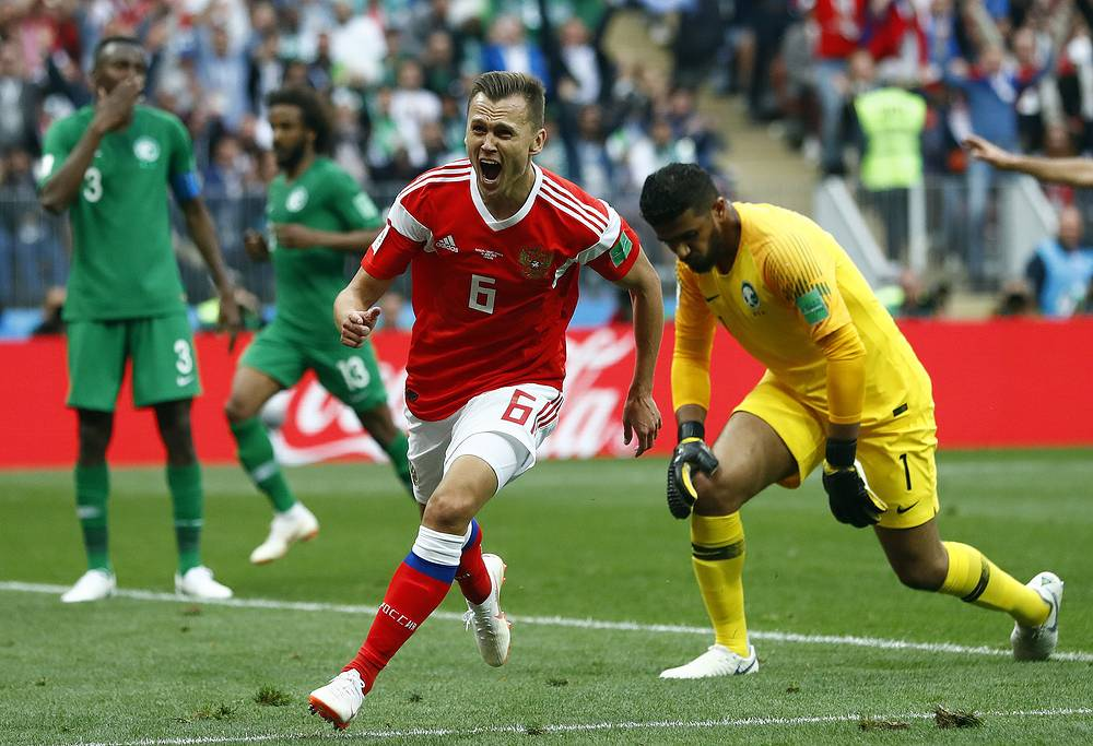 Russia's Denis Cheryshev celebrates after scoring his side's second goal during the group A match between Russia and Saudi Arabia at the Luzhniki stadium in Moscow