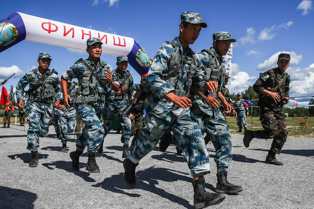 Participants from the People's Republic of China compete in a relay race for air assault units with small arms