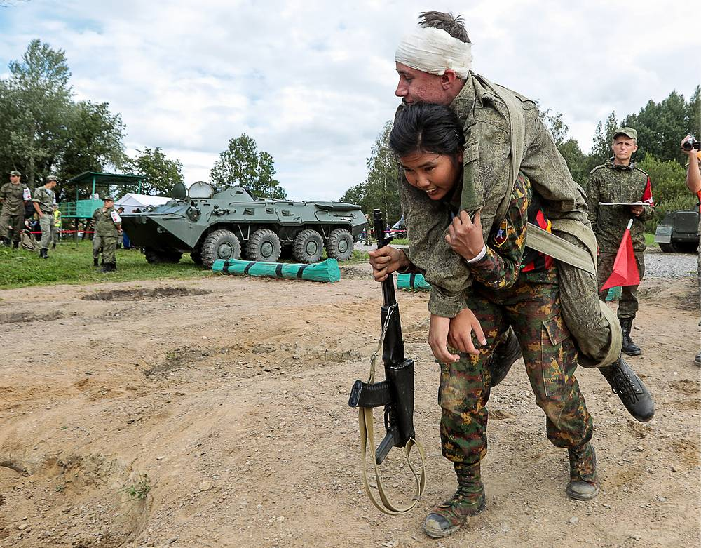 Servicemen from Myanmar take part in the military medical relay race