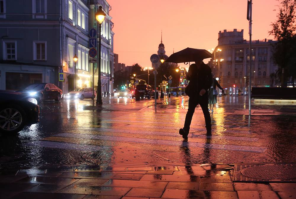A man walking in the rain in central Moscow, August 15