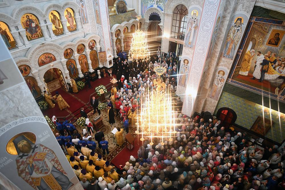 Russian Orthodox clergy and believers during the arrival of relics of Saint Spyridon of Trimythous from Corfu, Greece, at the Church on Blood in Honour of All Saints Resplendent in the Russian Land, in the city of Yekaterinburg, August 30