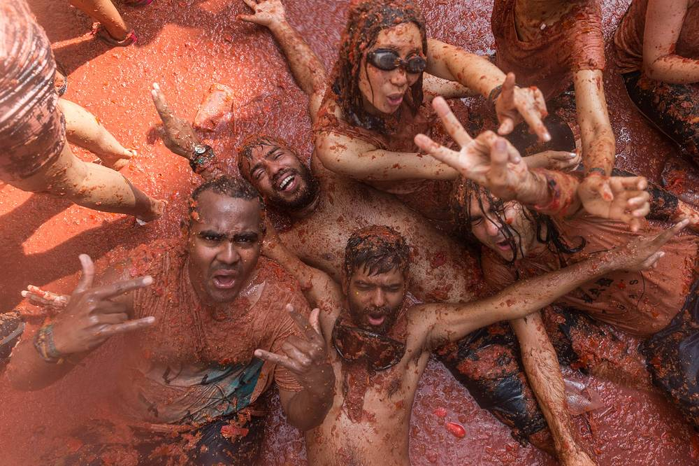People take part in the traditional Tomatina fight in Bunol, August 29. Tomatina is a battle in which tons of ripe tomatoes are used as weapon