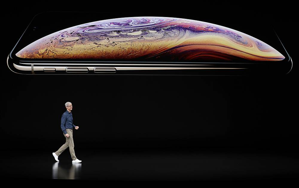 Apple CEO Tim Cook speaks about the Apple iPhone XS at the Steve Jobs Theater during an event to announce new Apple products in Cupertino, September 12