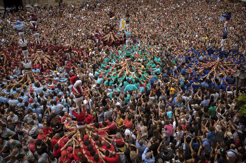 "Members of the Castellers form a human tower or ""Castel"" during the Saint Merce celebrations in San Jaime square in Barcelona"