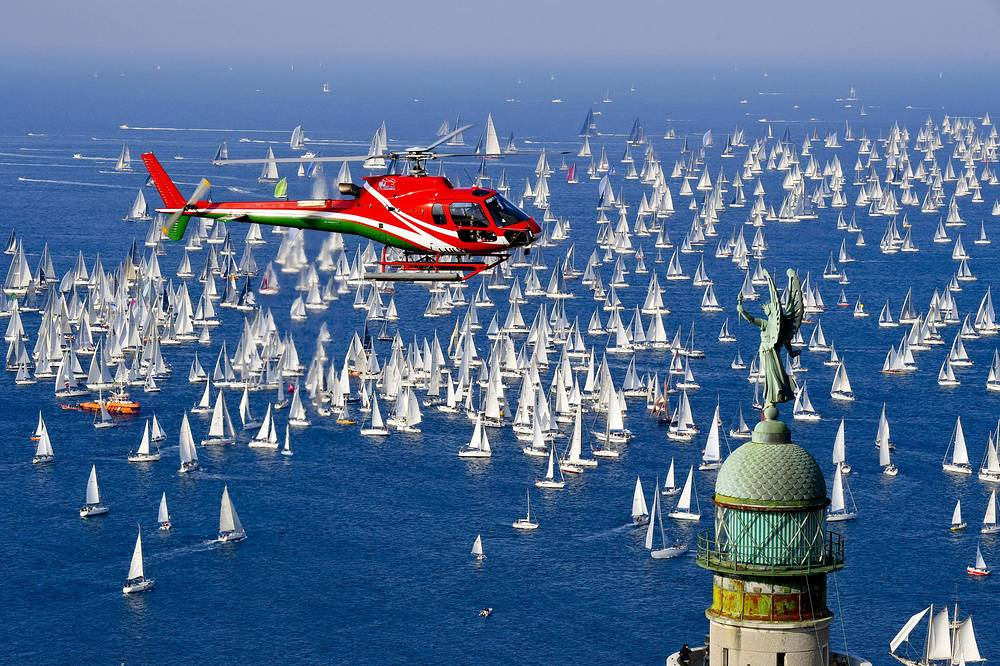 The 'Victory Lighthouse' overlooks hundreds of sailing boats as they crowd the Gulf of Trieste at the start of the 50th edition of the traditional 'Autumn Cup - Barcolana' regatta in Trieste, October 14