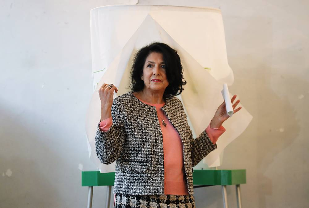 Salome Zurabishvili walks out of a voting booth at a polling station during a second round of the 2018 Georgian presidential election