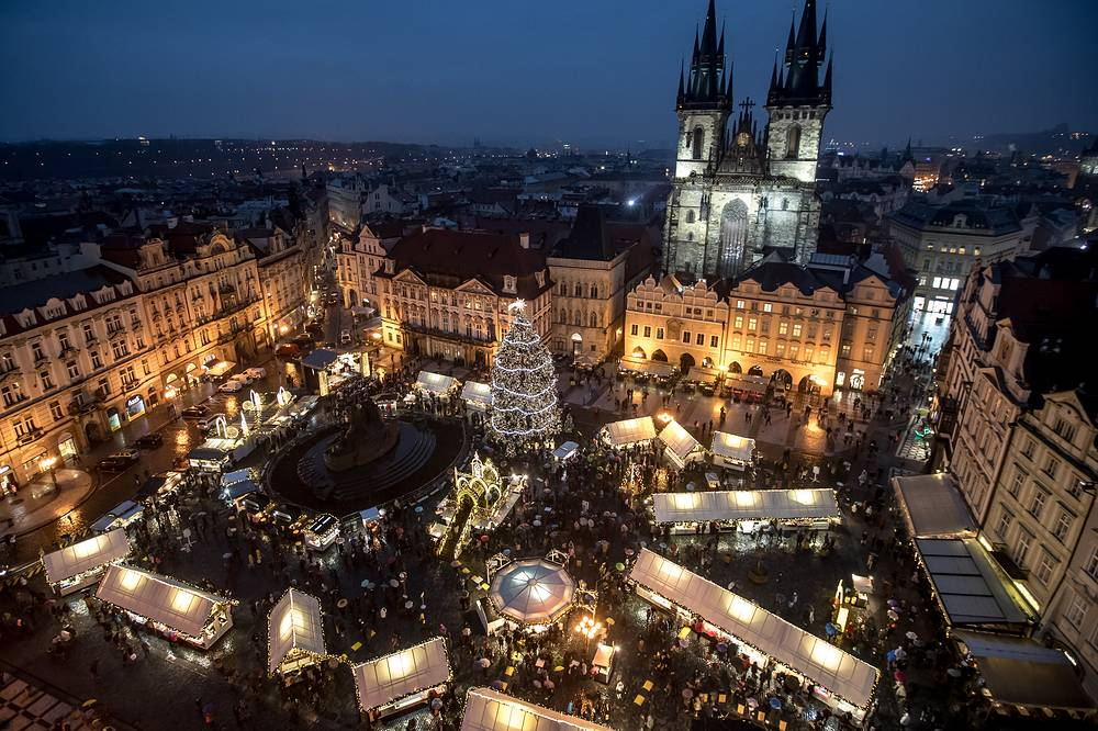 Illuminated Old Town Square with a Christmas tree in Prague, Czech Republic