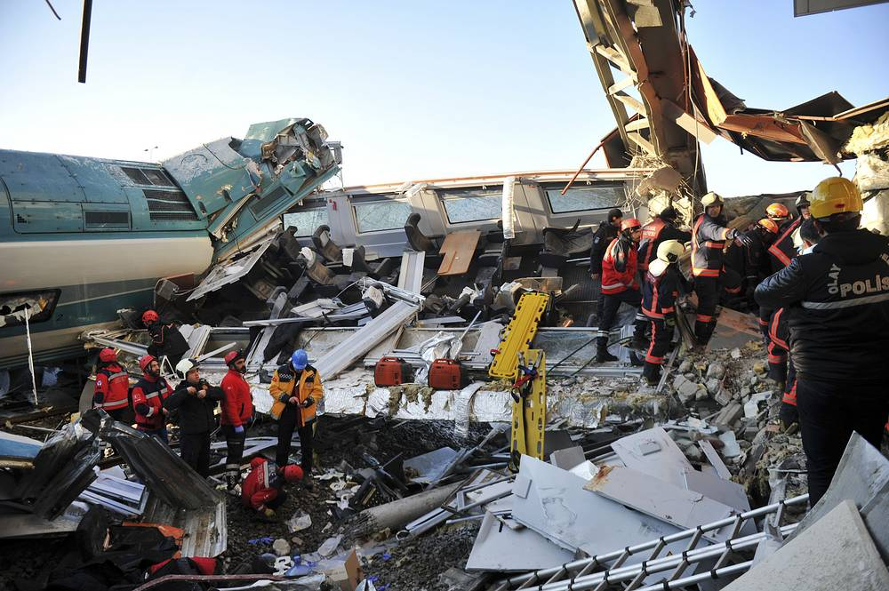 Members of rescue services work at the scene of a train accident in Ankara