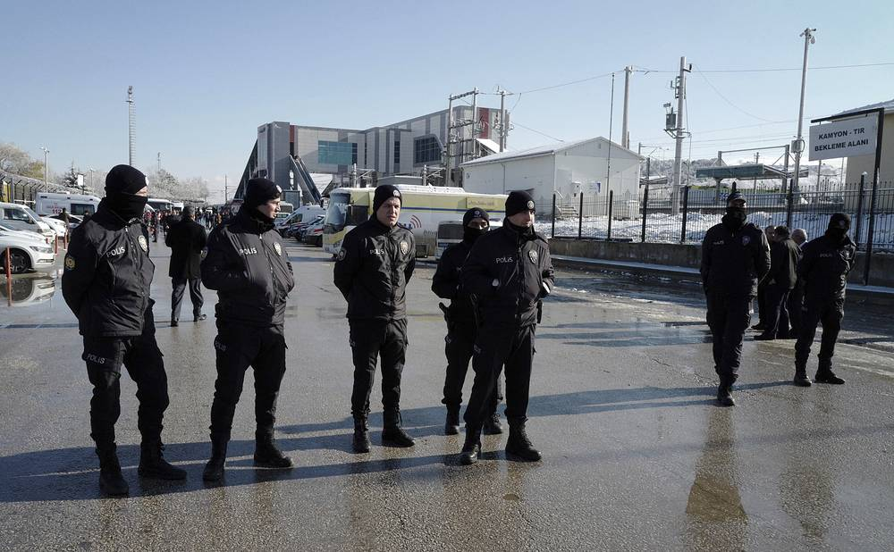 Police officers work at the scene of a train accident in Ankara