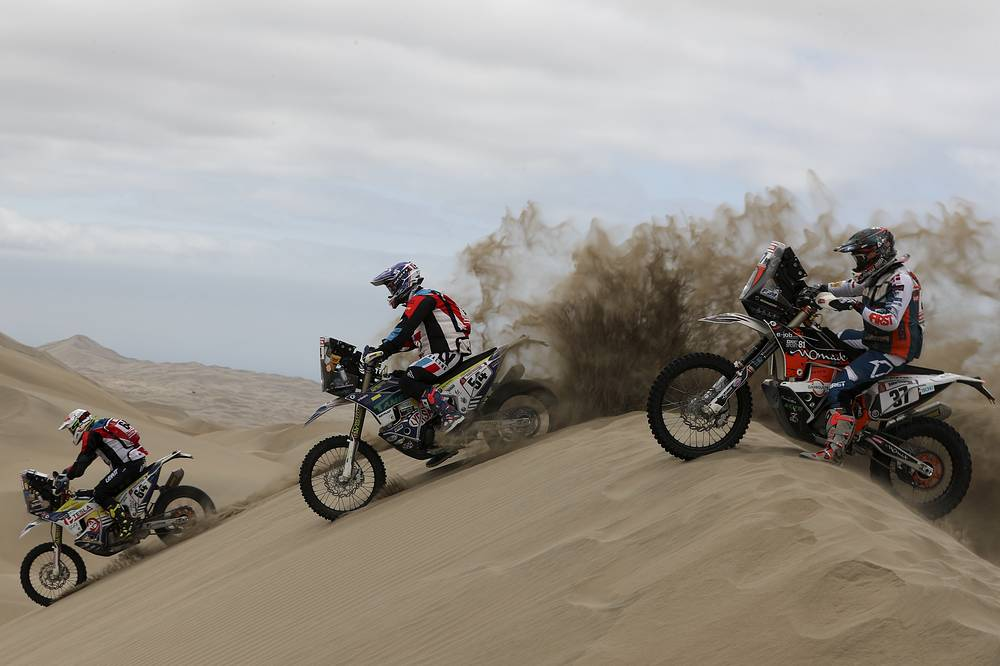 KTM rider Oscar Romero Montoya of Spain, Husqvarna rider Fausto Mota of Spain and KTM rider Loic Minaudier of France race their motorbikes during stage six of the Dakar Rally between Arequipa and San Juan de Marcona, Peru, January 13