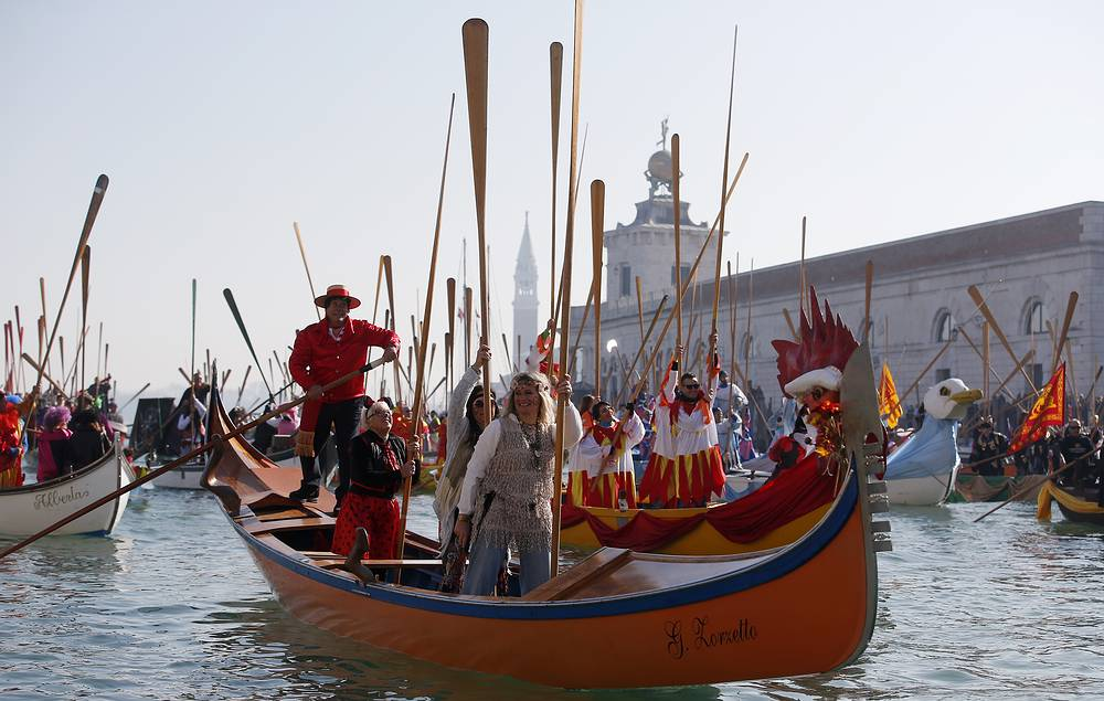 Boats sail during the water parade in Venice