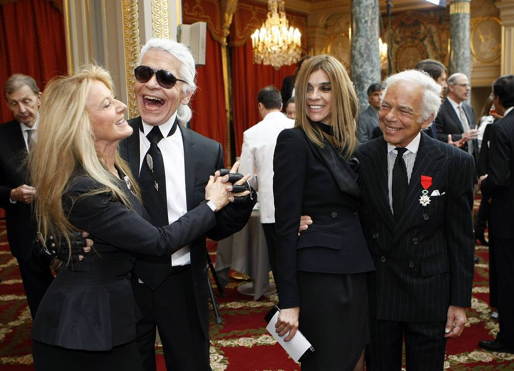 US fashion designer Ralph Lauren and Editor-in-Chief of the French edition of Vogue, Carine Roitfeld watch as Karl Lagerfeld dances with his wife Ricky Lauren during a ceremony in Paris, 2010