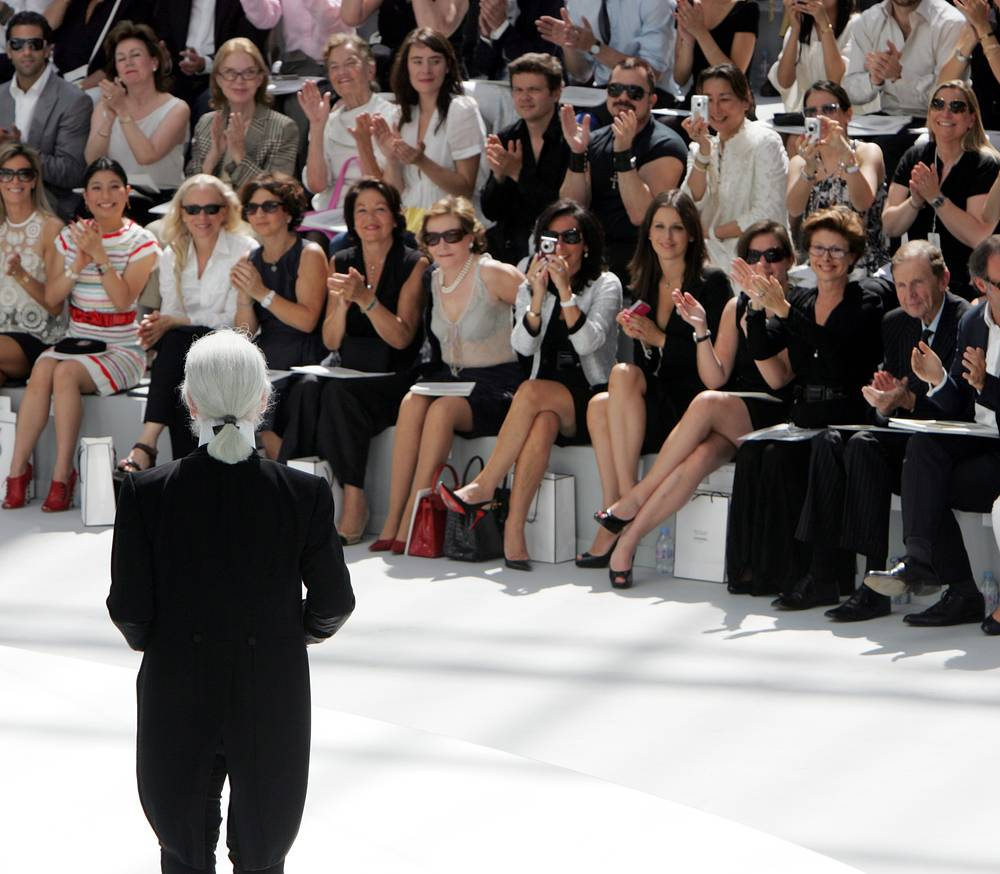 Karl Lagerfeld acknowledges applause, at the end of the presentation of Chanel Fall/Winter 2008/2009 collection, 2008