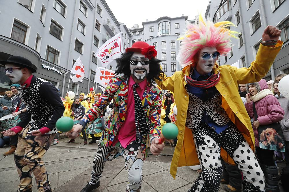 Actors of clown-mime theatres and local citizens celebrating the Humor Day in central St. Petersburg, March 31