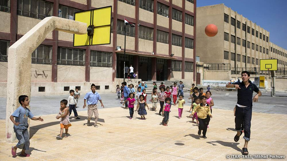 September 17. Children playing at the sportsground of a local school, which has been transformed to a refugee center.