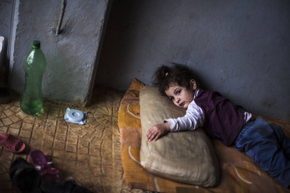 Rada Hallabi, 4, who is sick with diabetes, lies on a blanket in a refugee camp on the border with Turkey, near Azaz village, Syria, Sunday, Sept. 30, 2012. AP Photo / Manu Brabo