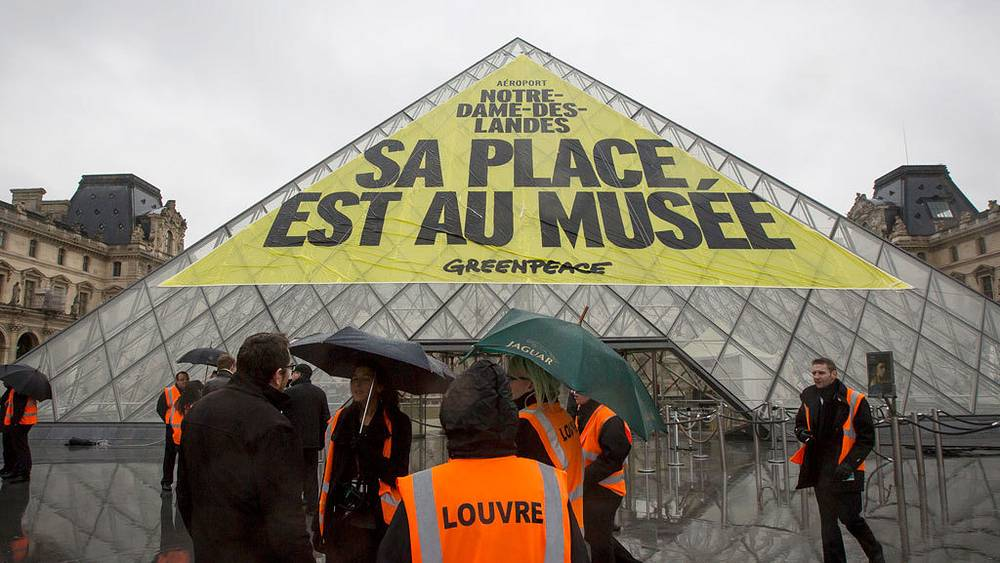 Banner on the roof of the Louvre, Paris, 2012