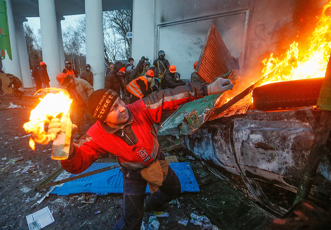 A protester throws a Molotov cocktail during an anti-government protest in downtown Kiev