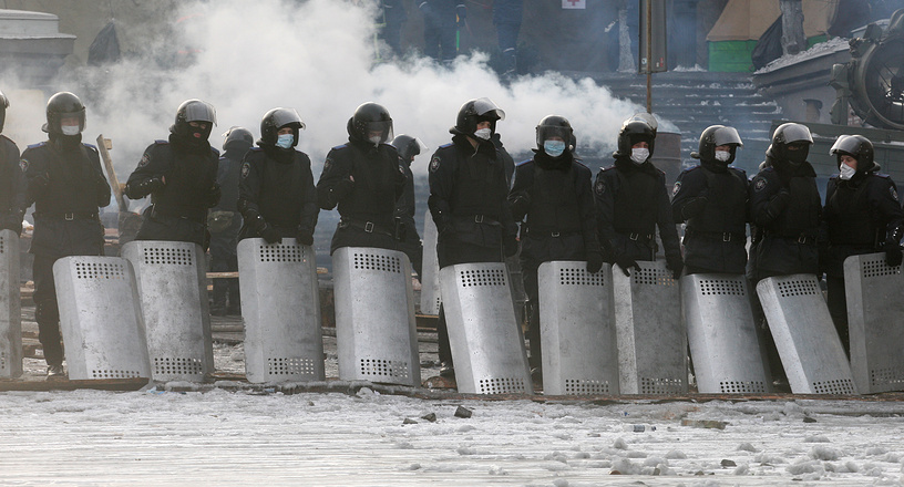 Ukrainian riot police stand in line during another day of anti-government protest in Kiev