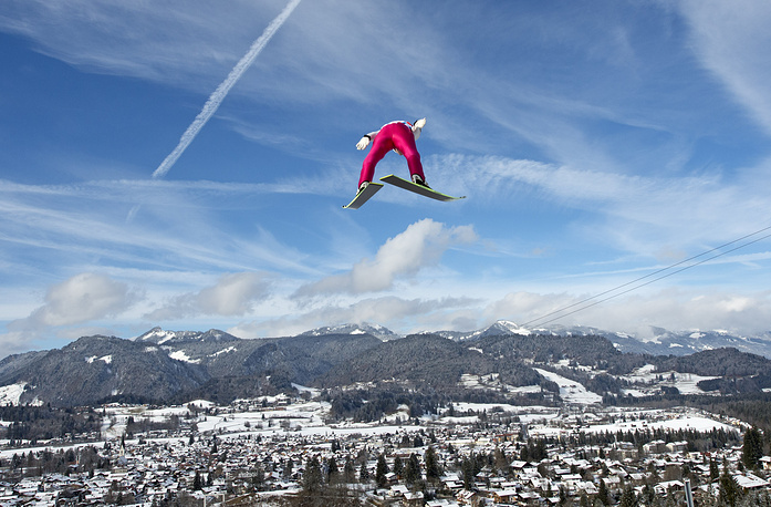 Nordic combined is a winter sport in which athletes compete in both cross- country skiing and ski jumping (photo)