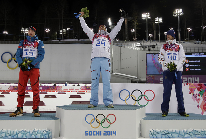 Norway's Ole Einar Bjoerndalen, center, winner of the men's biathlon 10k sprint, celebrates with silver medalist Austria's Dominik Landertinger, left, and bronze medalist Czech Republic's Jaroslav Soukup, at the 2014 Winter Olympics