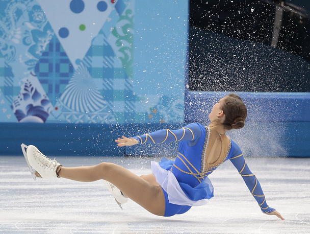 Andrea Davidovich falls as she and Evgeni Krasnopolski of Israel compete in the pairs free skate figure skating competition