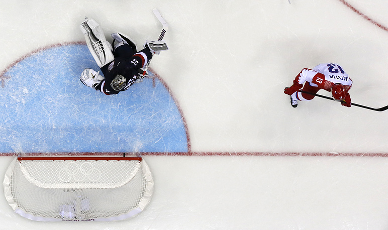 Russia's Pavel Datsyuk (R) scores against goalkeeper Jonathan Quick (L) of the USA