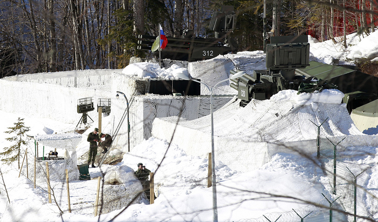 Russian military watch the surrounding of the cross-country skiing venue from their anti-aircraft missile base