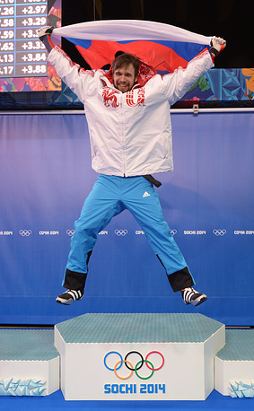 Alexander Tretiakov of Russia celebrates after winning gold in the Skeleton competition