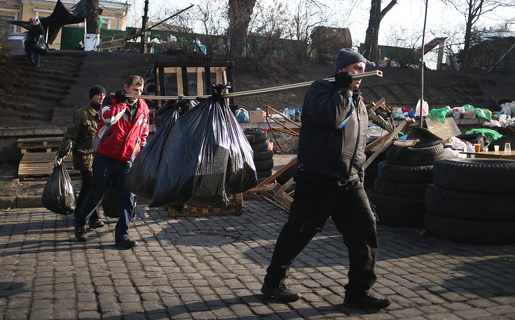 Kiev citizens are cleaning up the city after violent protest that shook the city last week